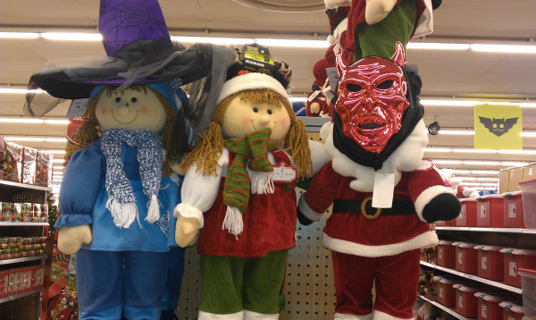 Christmas Kids Before Halloween Dressed Up for Tricks